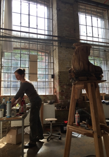 Sculptor Laura Eckert at work in her studio with sculpture