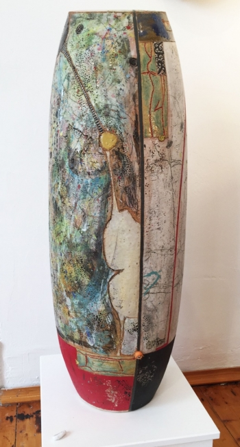 tall cermaic vessel with colourful hand drawn glazes and textures