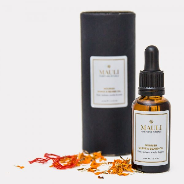 Mali Beard oil with packaging and petals
