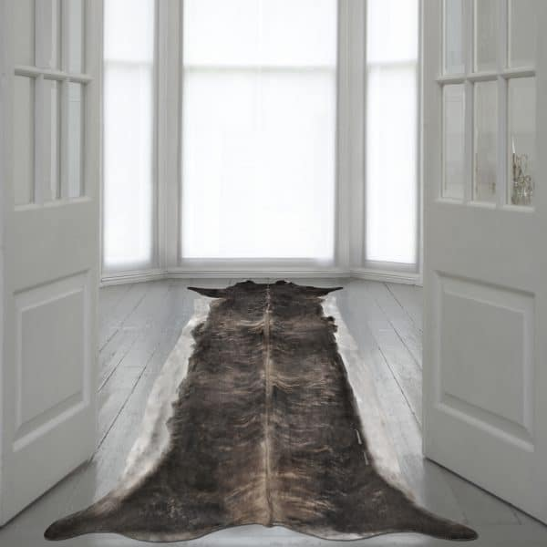 Super Long Stretched cowhide natural on wood floor