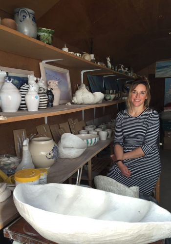 Charlotte Cadzow in her studio with clam shell sculpture