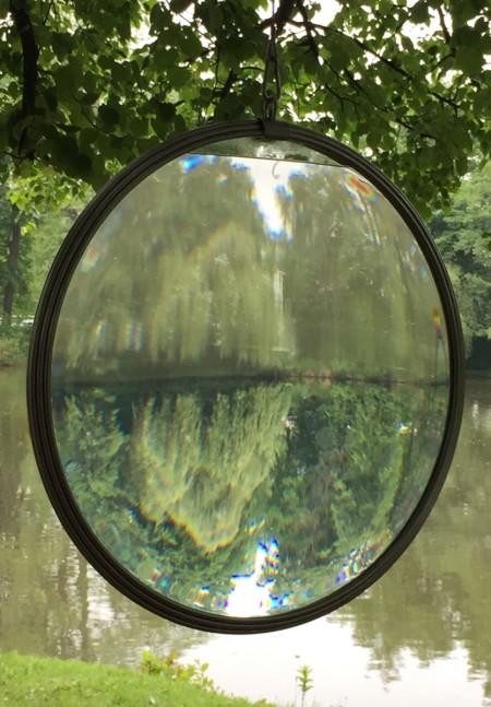 Hanging giant glass lens sculpture