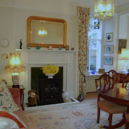 Classical dining room with fireplace and large dining table