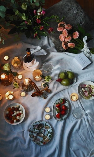 romantic candlelit picnic indoors