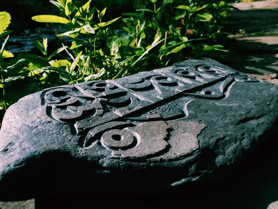 A hand carved Tibetan Mani Stone sold by Curious Egg