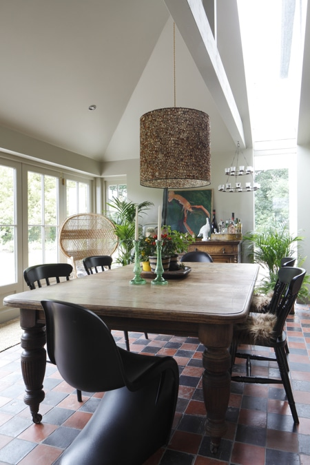 Boho chic kitchen with rustic table and eclectic decor