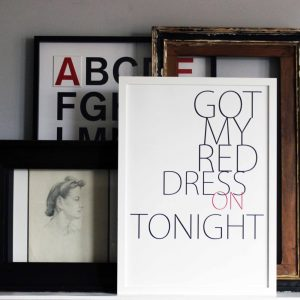 Got my Red Dress on Tonight art print by We are Amused 30 x40 black and red text stacked woth other framed prints on display