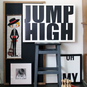We are Amused art print 30 x 40 with Jump High text in monochrome shown against a blue ladder and with other prints