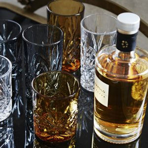 amber and smoke cut glass whisky glasses pictured with a bottle of whisky