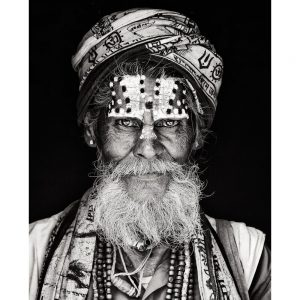 Holy Sadhu Indian Holy Man with decorative turban and painted face.  Photo by Mario Gerth for sale at curiousegg.com