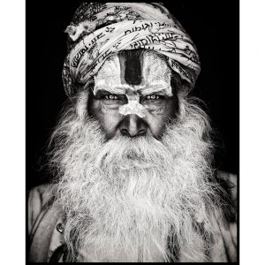 Holy Sadhu Indian Holy Man with turban and full white beard and amazing piercing eyes.  Photo by Mario Gerth for sale at curiousegg.com