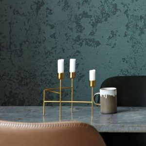 Gold Strand candleholder lifestyle on marble table