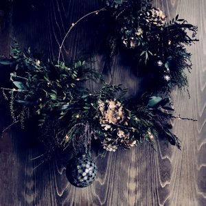 Christmas wreath with fairy lights and rustic foliage