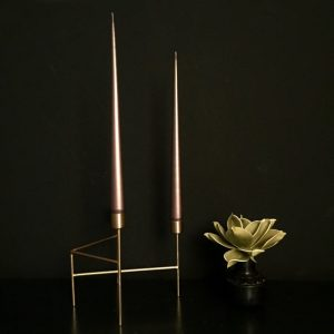 Bronze taper candles in gold candleholder