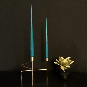 teal taper candles in gold candleholder