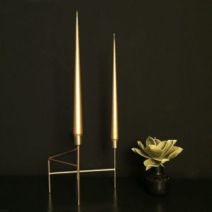 Gold taper candles in gold candleholder