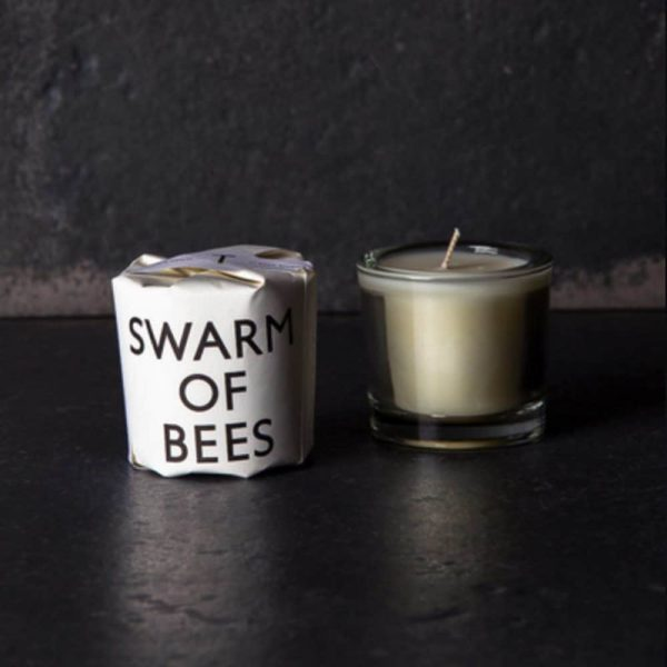 Swarm of Bees candle by Tatine against dark background
