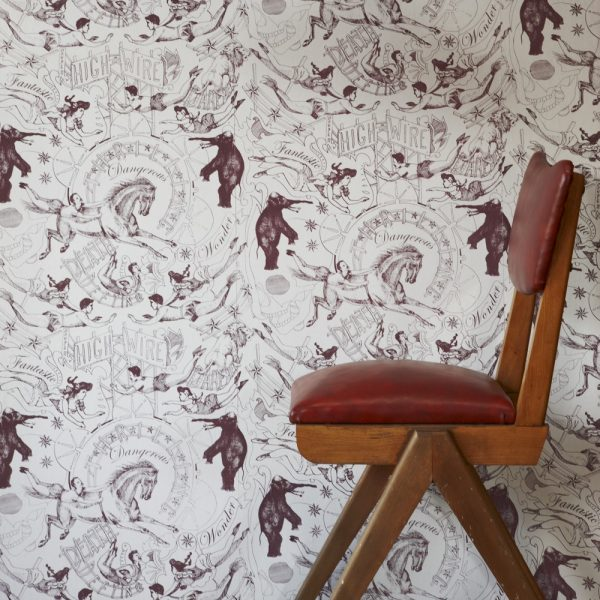 Highwire wallpaper by Daniel Heath in grape colour with chair