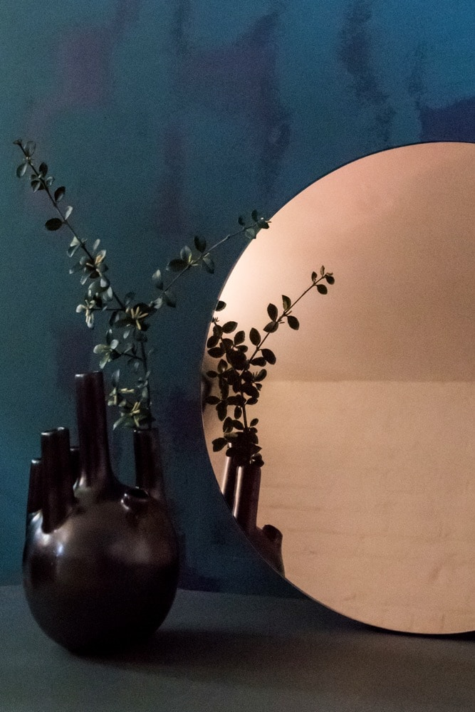 The Sun Mirror is a perfect disc of rose gold mirror glass - a sculpture and functional piece in one it reflects a warm glow around the room adding a magical circle of copper to the space. You'll find you spend a lot of time staring into it - hypnotised by its beauty!