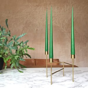 Hand dipped taper candles in Emerald colour in gold candle stand