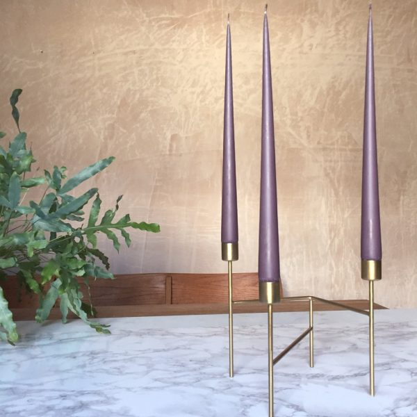 Hand dipped taper candles in French Lavender colour in gold candle stand