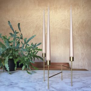 Hand dipped taper candles in Nude colour in gold candle stand