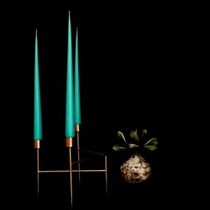 Hand dipped taper candles in Turquoise colour in gold candle stand