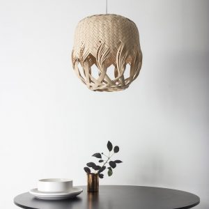 Pren Shadow 03 - hand woven sculptural rattan light fittings hanging above table with white crockery and copper pot