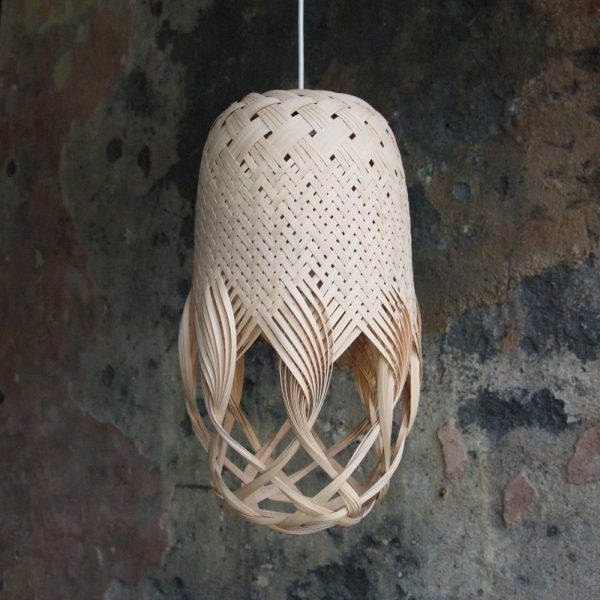 Pren Shadow 06 - hand woven sculptural rattan light fitting with rough cast wall in the background