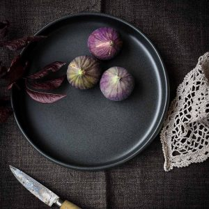 Black Ceramic Plate bowl with figs and a lace cloth