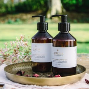 Mauli Hand and body lotion on gold tray in spring meadow