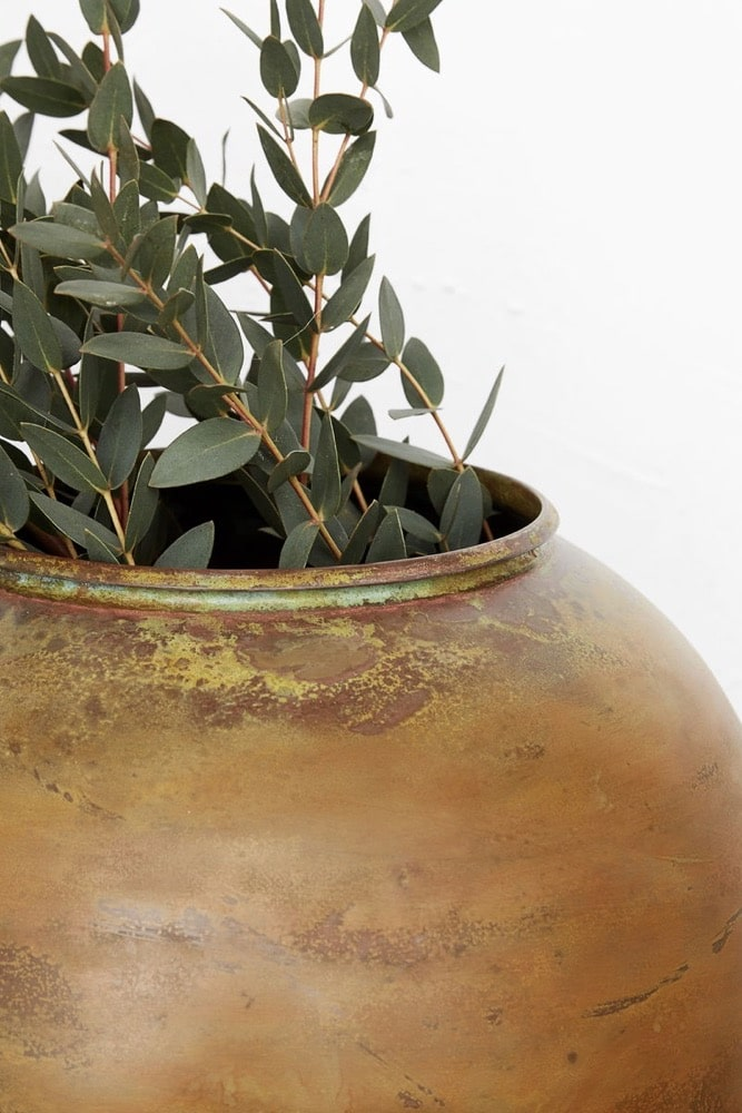 The Taiyou is a stunning large vase with a deeply patinated gold/mustard surface that has been hand worked to give a truly characterful finish. Carefully formed in brass, this is a special piece worthy of thoughtful display and something grand put in it! Taiyou means \'sun\' in Japanese which perfectly describes the warmth of its colour and rotund shape. It\'ll make easy work of showing off theatrical blooms and twisted branches with catkins. It looks equally impressive on its own on display!
