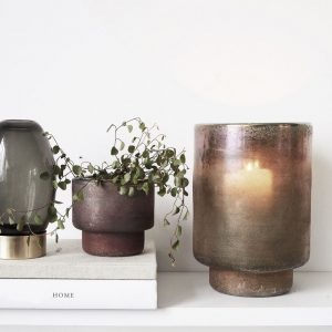 metallic pink and brown glass planter on shelf