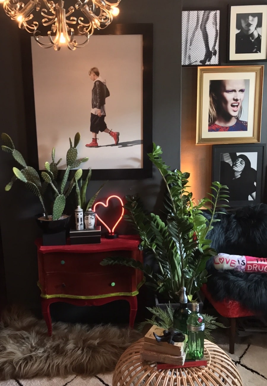dark walls in a living room with artworks and a painting by Nigel Cox