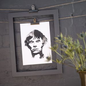 ink blot style image of Andy Warhol art print hanging against a dark grey wall by Jenn Rea