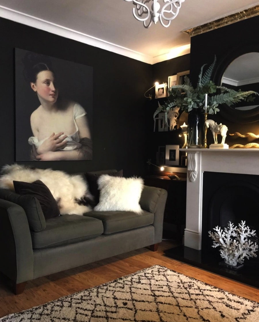 dark walled living room with artwork