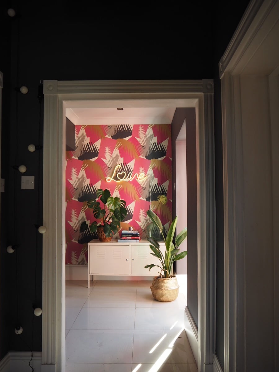 pink tropical wallpaper in a room
