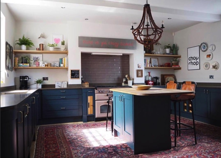 large kitchen with vintage rug and neon