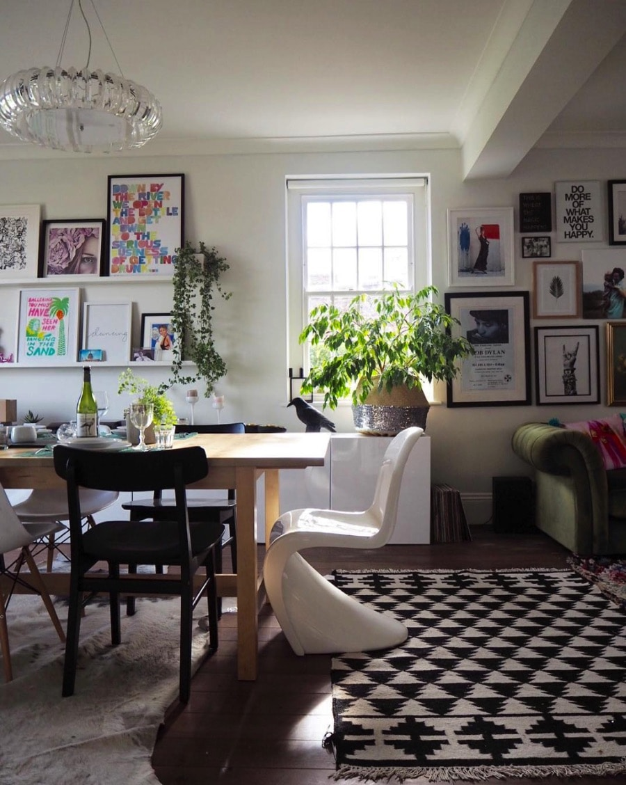 eclectic dining space with black and white patterned rug
