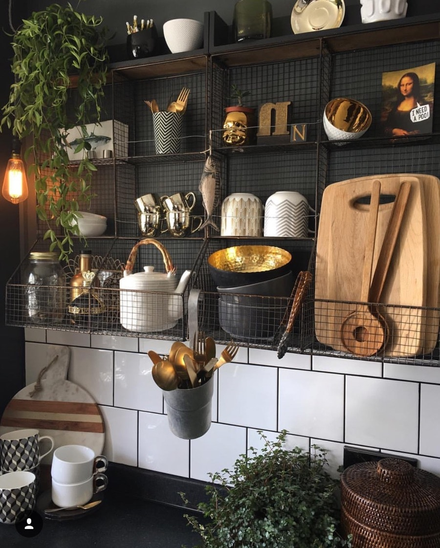 quittance shelving with gold accessories and wooden chopping boards
