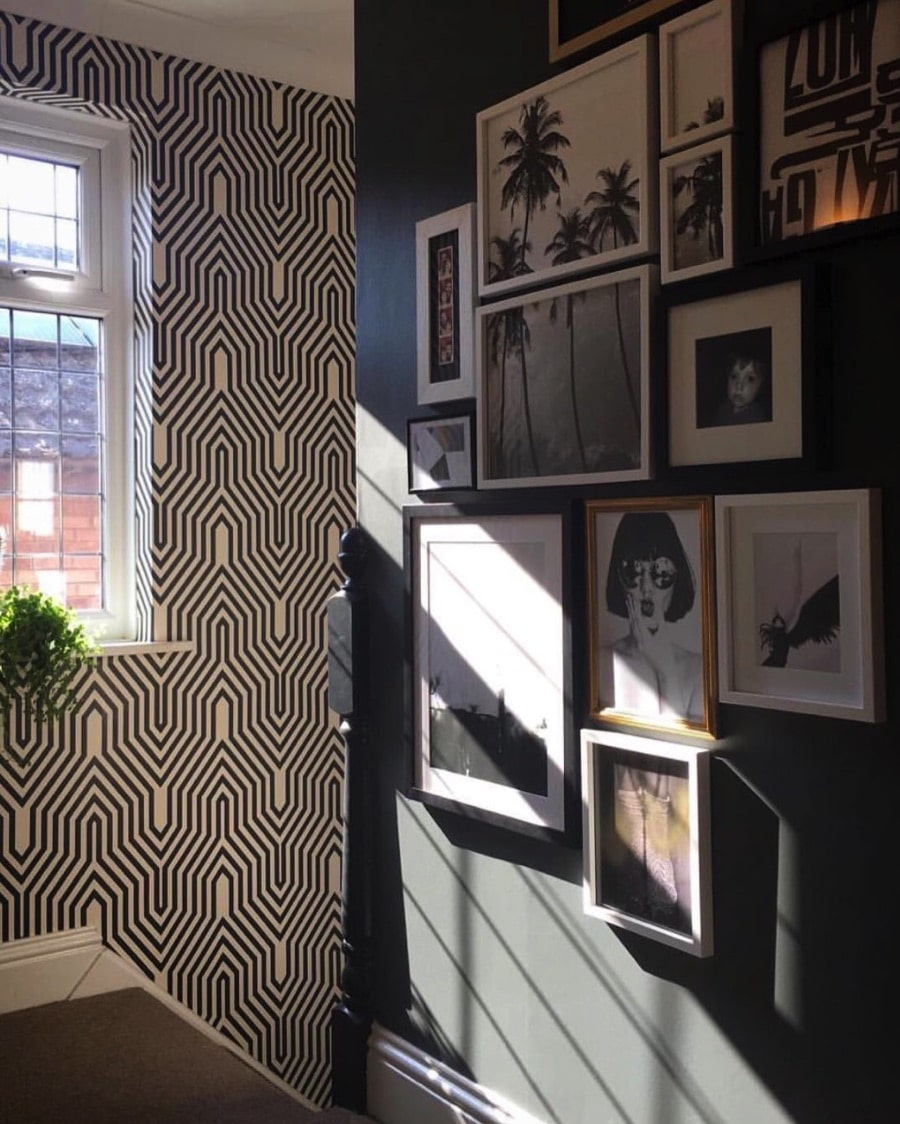 stairwell with art and graphic patterned wallpaper