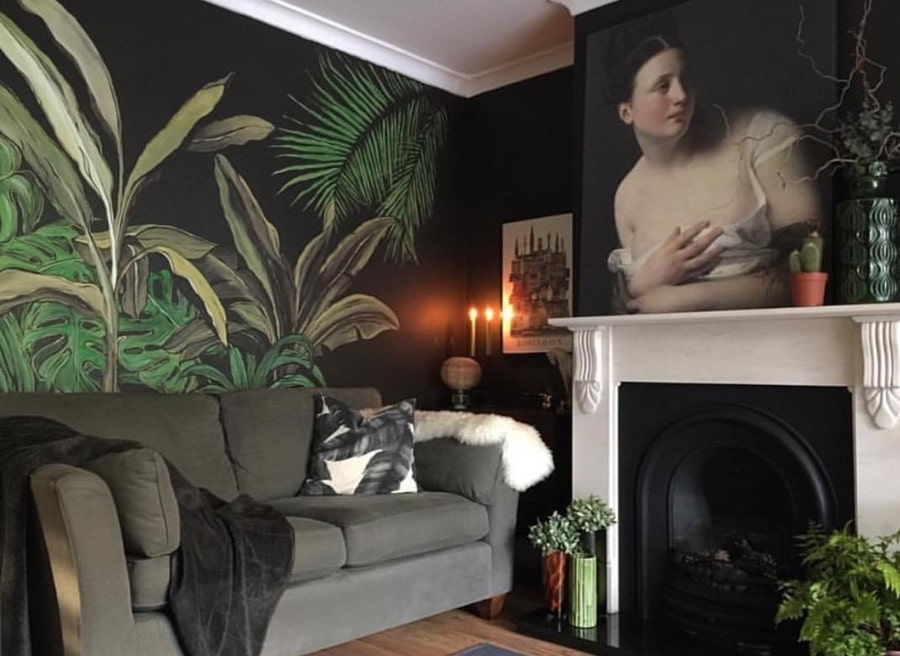 room with tropical handpainted mural and classical artwork on wall above fireplace