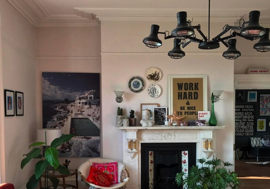 eclectic living space with slim Aaron art on wall