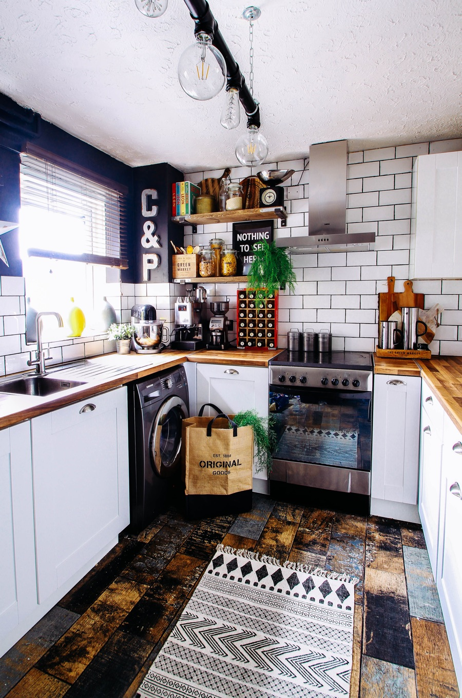 modern kitchen with white subway tiles and industrial vibe
