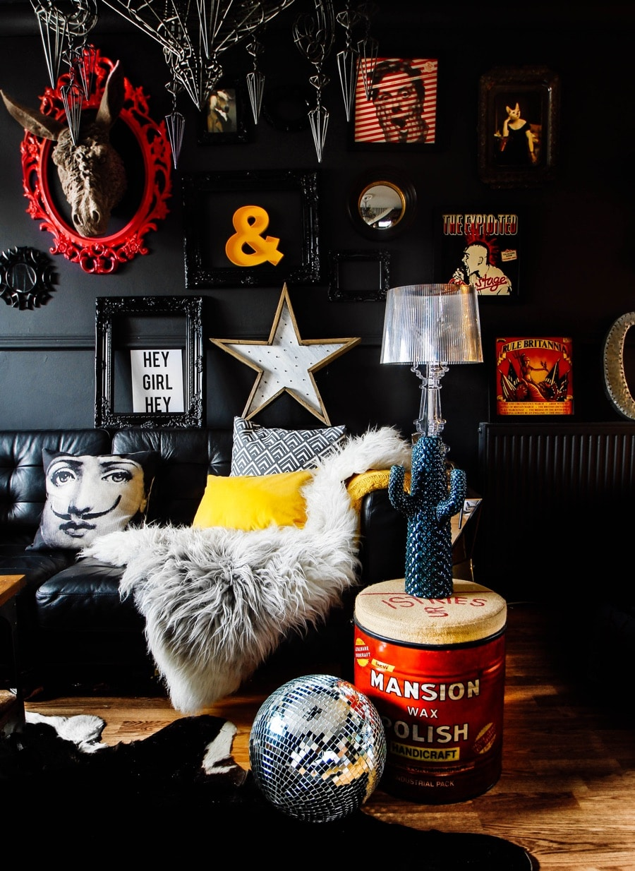 living room with dark walls and bold colourful accessories with rock glam vibe