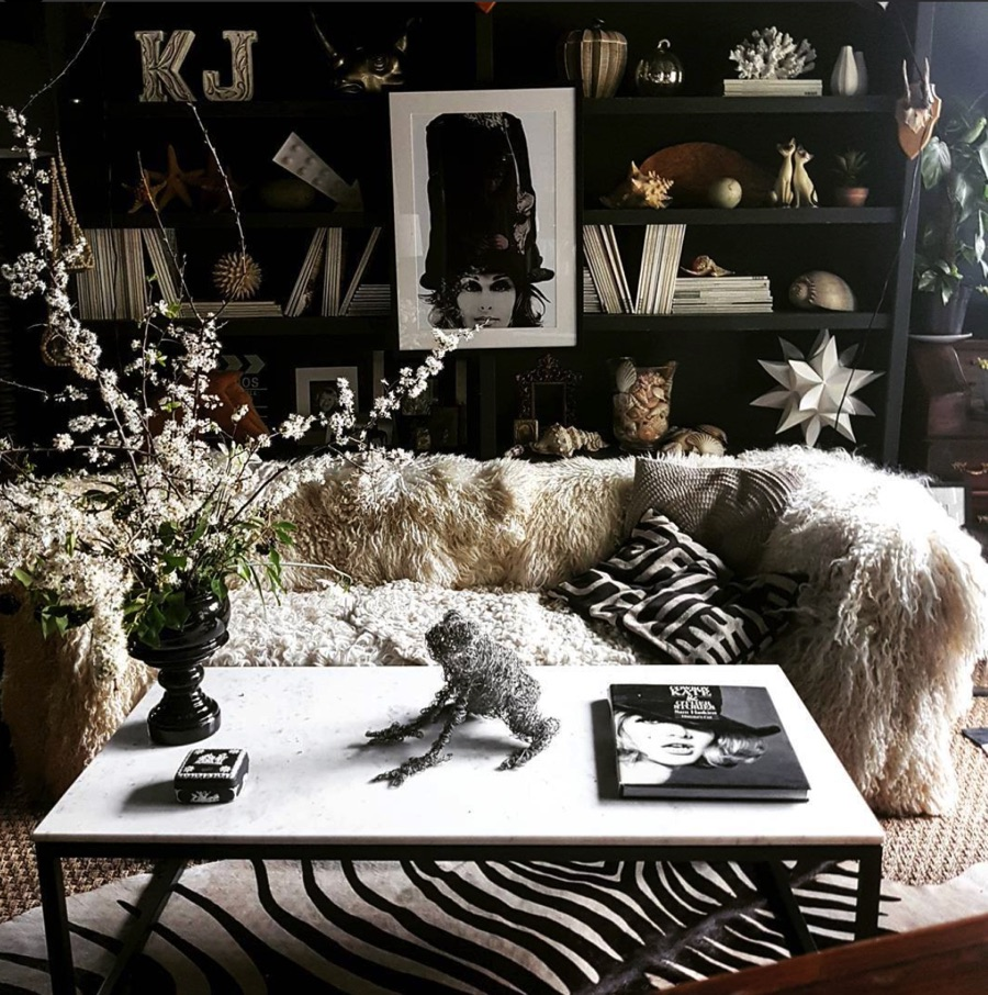 styled shelving with home accessories and boho style sofa with sheepskins