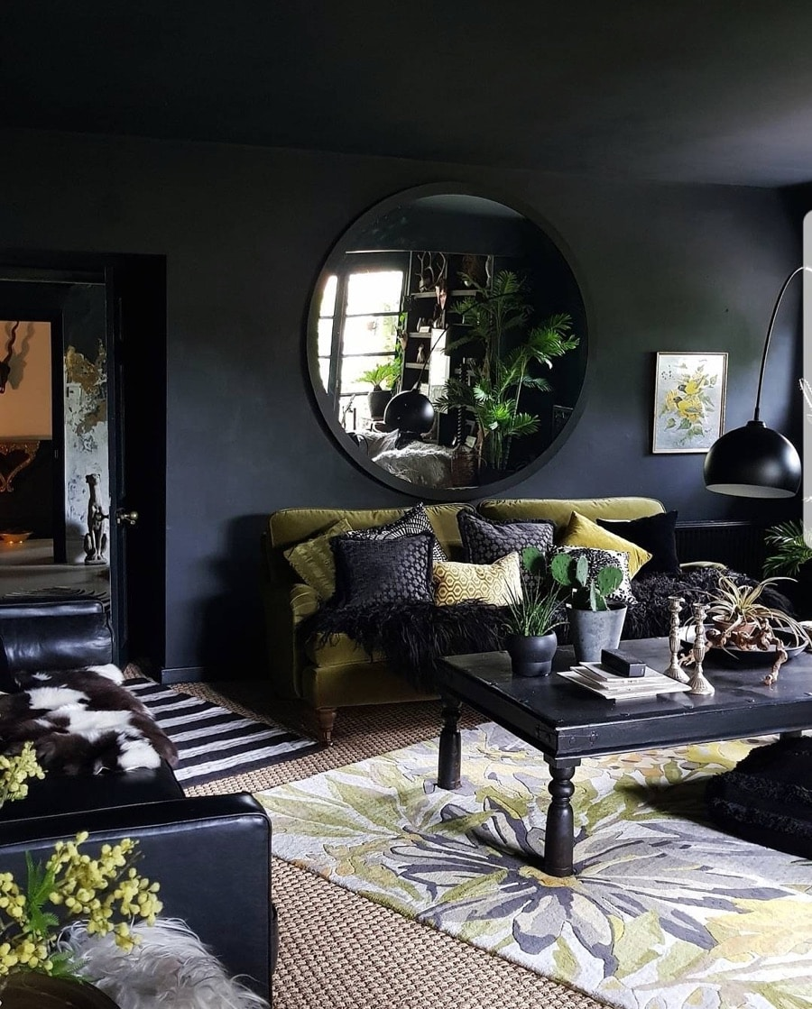 dark walls in a living room with large circular mirror