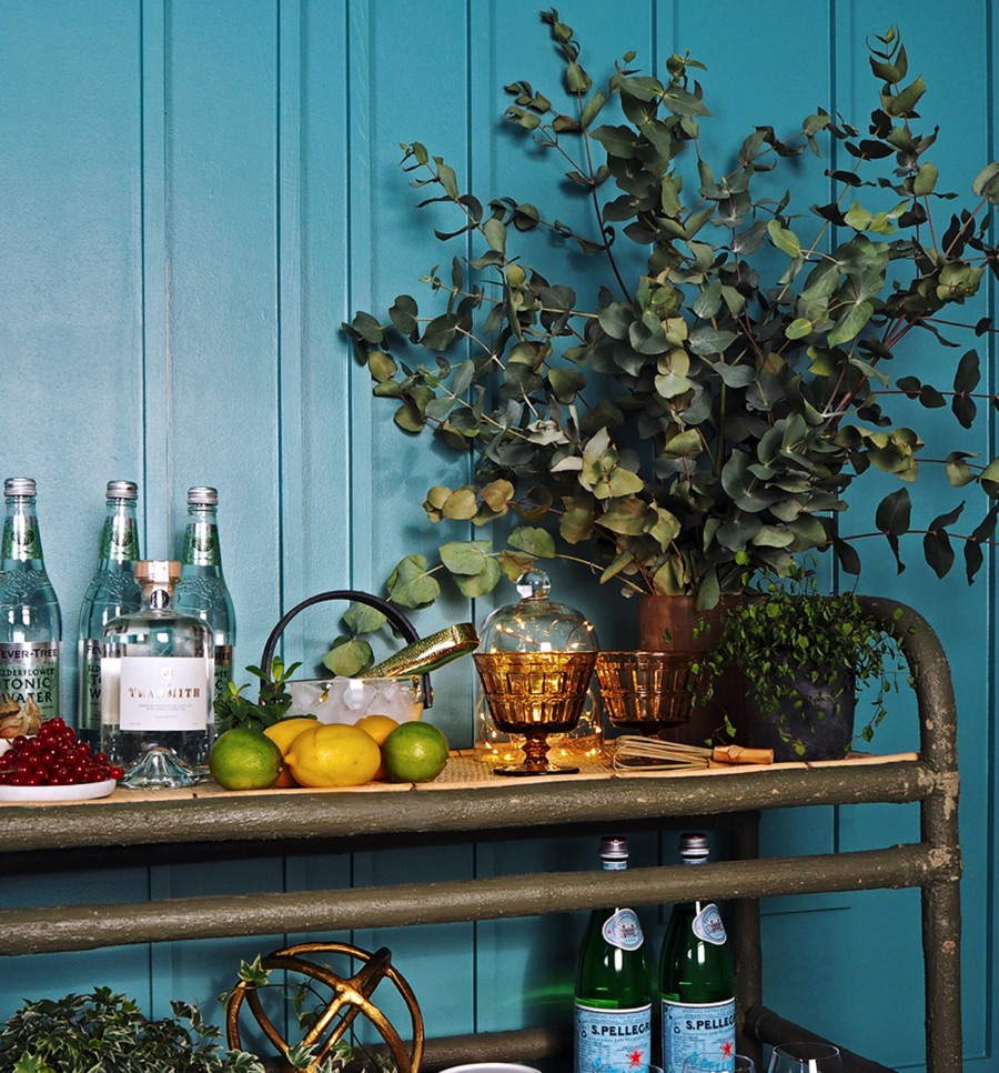 gin cocktail bar with foliage and the tea smith gin