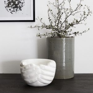 Hand carved clasped hands vase in white marble cut out on white background