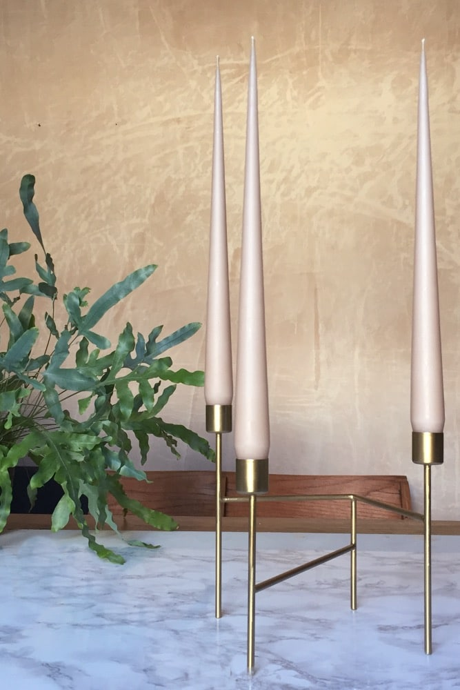 These beautiful nude tapered candles are made in Denmark using the highest quality traditional hand dipped methods. Their long, lean shape with thin elegant points makes them the finest taper candles you'll find. Perfect for weddings or admiring every day! Pair three with our Gold Strand candleholder for a stunning centrepiece or theatrical table display. 